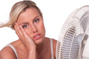 overheated-woman-with-fan